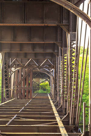 Old rusty bridge over the river Stock Photo