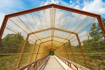 Overpass bridge covered with mesh Stock Photo