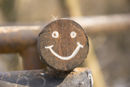 Smiling face on round metal construction