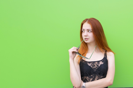 Cute girl on green background