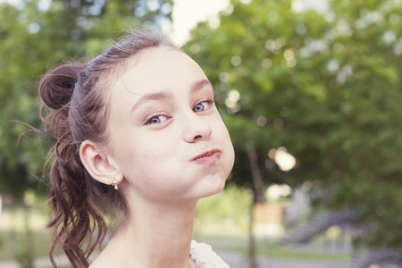 Young girl puffing out her cheeks