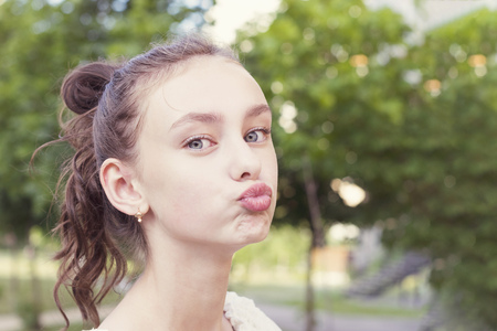 Girl keeps lips as going to kiss someone