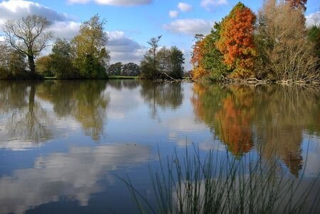 Autumn lake scene showing a strong reflection from the water Stock Photo - 2369262