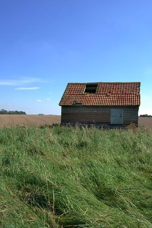 Old ruin of a shed in the middle of a field Stock Photo - 2444635
