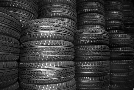 pneumatic tyres: Store room full of new car tyres Stock Photo