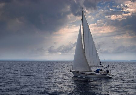 Sailing boat heading into a storm Stok Fotoğraf