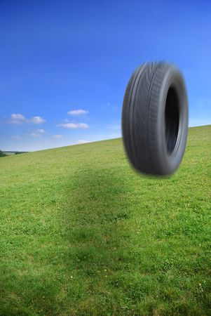 Tyre rolling and bouncing downhill Stock Photo - 2444634