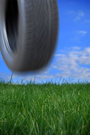 Tyre rolling and bouncing down a hill Stock Photo - 2444608