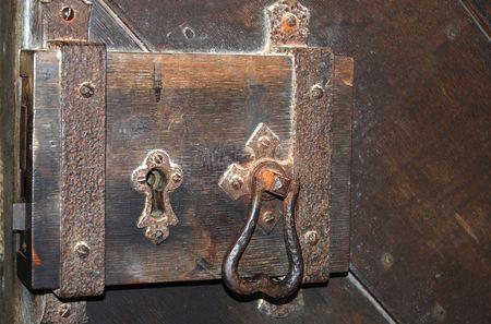 A very old door lock and handle Stock Photo - 3194400