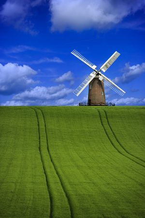 Focus on windmill in a beautiful field landscape Stock Photo - 3194396
