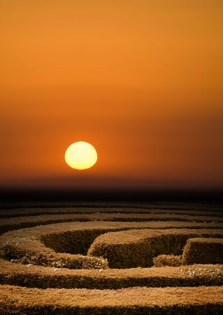 Hedge maze at sunset, problem solving concept Stock Photo
