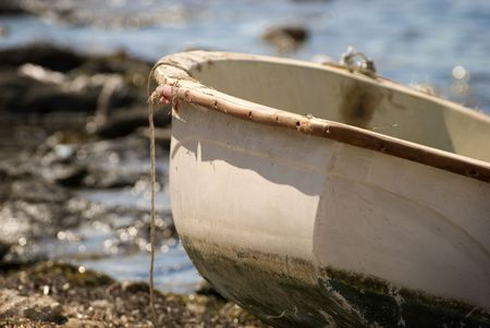 Old boat on the edge of a rocky beach Stock Photo - 3394001