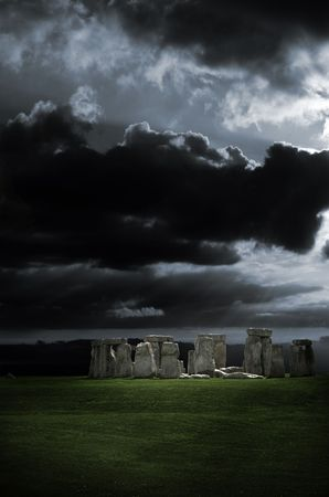 A dramatic stormy sky over stonehenge in Wiltshire