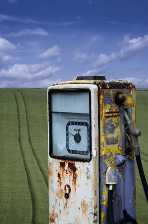 An old abandoned fuel pump set in a field landscape Stock Photo - 4124160
