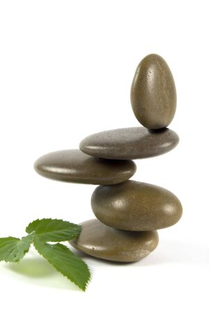 A stack of balancing pebbles on a white background Stock Photo - 4124155