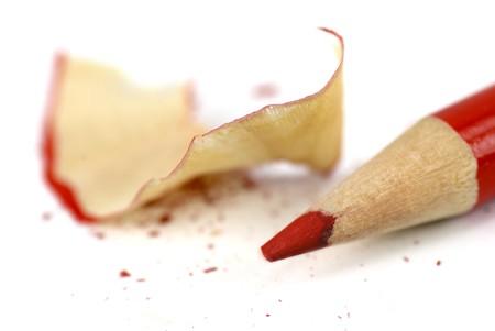 sharpenings: Macro shot of a red crayon and sharpenings