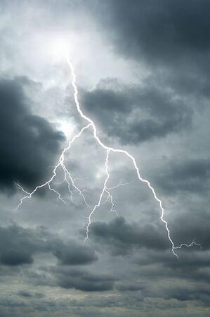 A Lightening bolt flashes through a dramatic sky