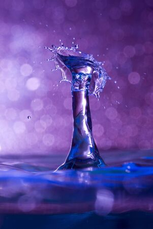 Brightly coloured capture of a water drop collision Stock Photo - 5300459