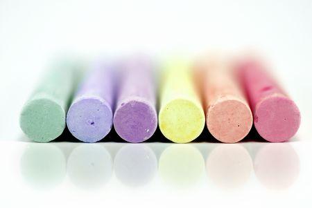 Rainbow arrangement of 6 different pastel colored chalk sticks