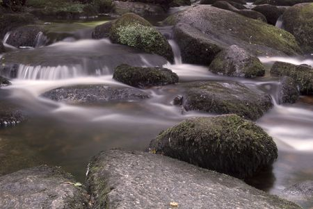 Water flowing over rocks in a mountain stream Stock Photo - 5457061