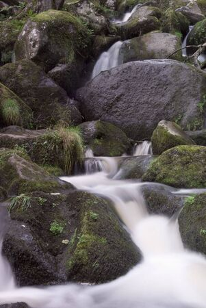 Water flow between rocks from a mountain stream Stock Photo - 5457069