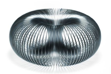 Metal slinky creating a symmetrical spherical pattern