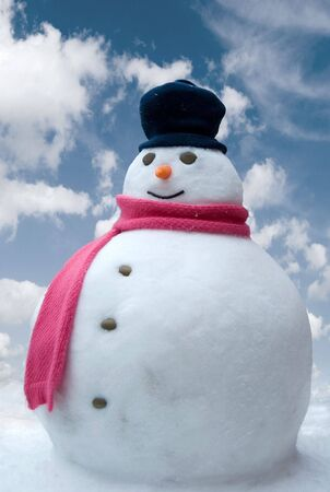 snowman: Happy snowman against a bright sky background Stock Photo