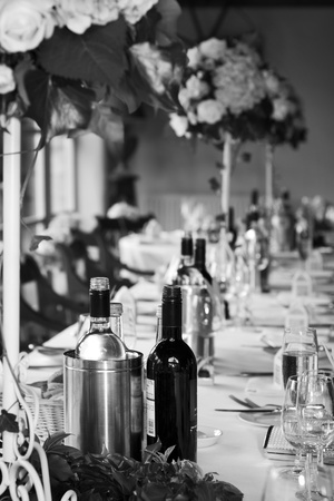 restaurant setting: Blank and white picture of a wedding reception arrangement