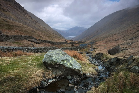 Stream flowing between the beautiful lake district mountains in Cumbria England Stock Photo - 9019882