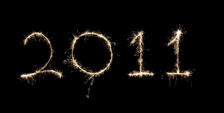 New year 2011 sign created from a sparkler Stock Photo - 9019890