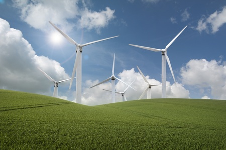 Windfarm producing clean renewable energy infront of a  blue sky and bright sun Stock Photo - 9019892