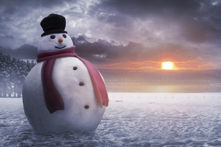 A happy snowman braves the cold of winter photo