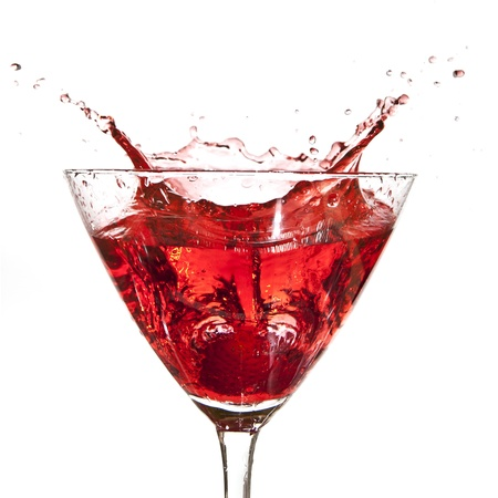 A Strawberry splashing when dropped into a cocktail
