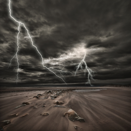 storm: Lightning flashes across the beach from a powerful storm