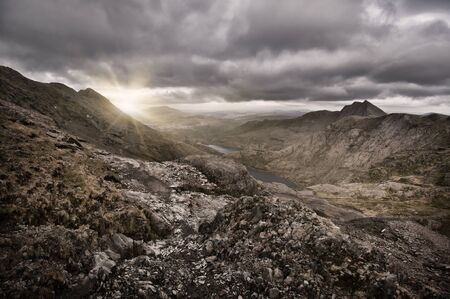 The sun rises over the mountain at Snowdon in Wales Stock Photo