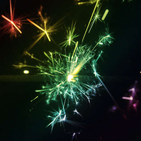 A multi coloured sparkler at night