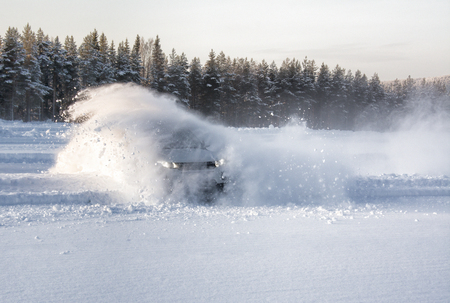 A vechical sliding into deep snow causing an explosion effect