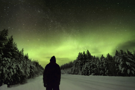 northern nature: Silhoutte of a man watching the Northern Lights Aurora Borealis