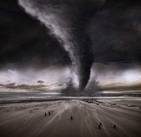 tornado wind: A tornado taring acroos a deserted beach