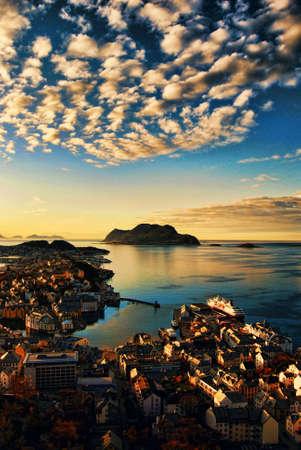 Sunset over Aalesund Harbor, Norway photo