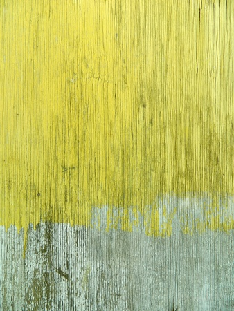 Weathered plywood wall with yellow paint. photo