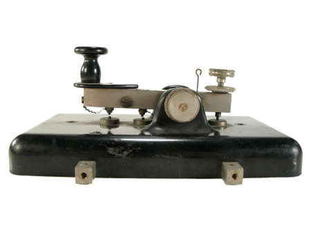 telegram: Original old morse key isolated on white.