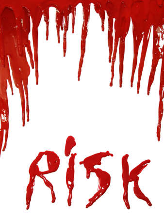 The word RISK in dripping red paint (as blooding) isolated on white photo