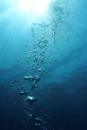 Bubbles undersea and sun rays  Stock Photo