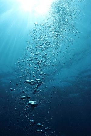 underwater diving: Bubbles undersea and sun rays  Stock Photo