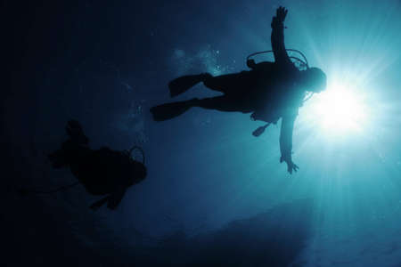 embolism: Divers in back-light Stock Photo