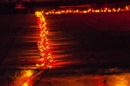 Glowing colorful lights on a dark background. Glitter, joy, beauty