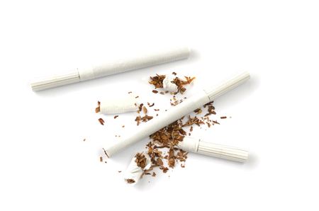 Differently lying cigarettes on a white background.