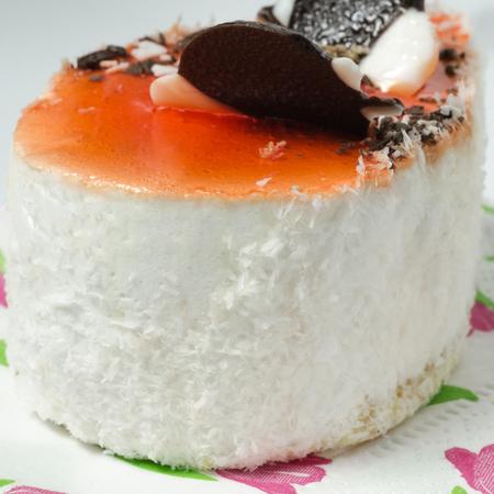 Tasty white cake on a white background. Stock Photo