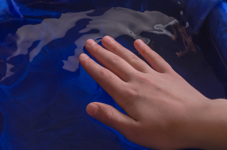Childrens hands in water and with water. Stock Photo